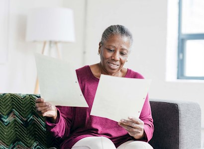 older woman reading financial documents