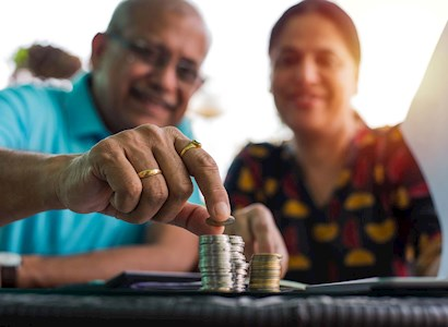 older couple stacking coins