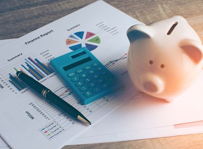 Piggybank on financial documents
