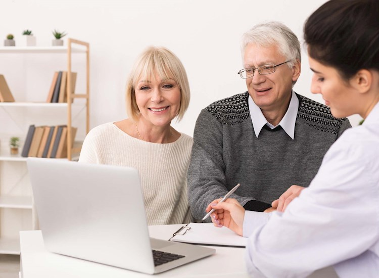 Couple working with a financial planner