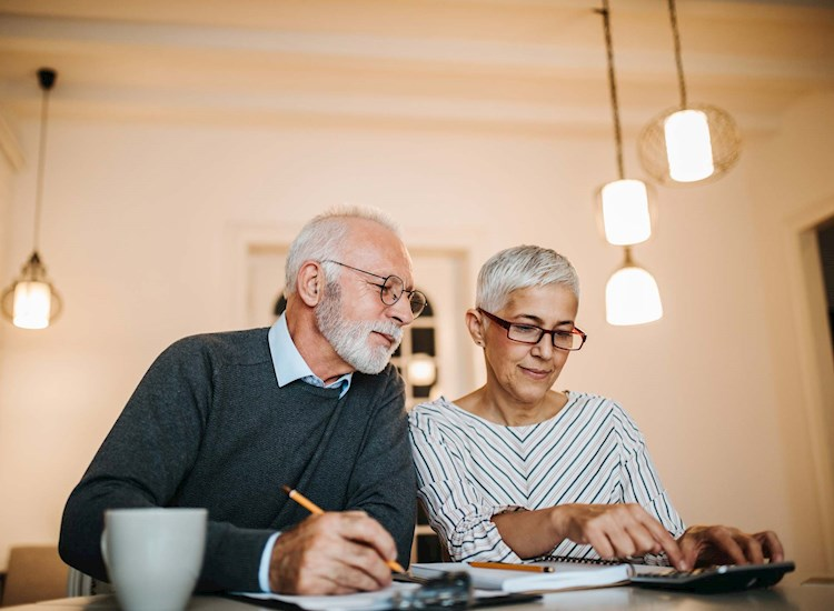 Couple looking at retirement income numbers.